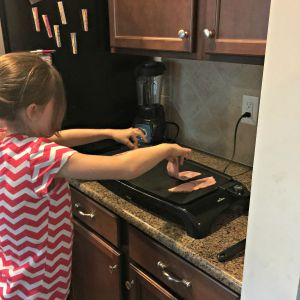 Daughter cooking slices